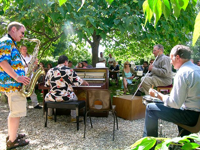 2006 UK Festival : Boogie Woogie Piano playing in the warm summer sunshine at Fontmell Magna, Dorset